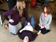 Kelly demonstrates how to check for a diastasis in a 30 week client... fun to feel the baby kick us!
