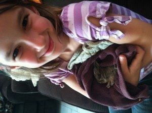 This is my girl holding a baby bunny she rescued from our cats and released back into the wild. She's drafting a book about it!