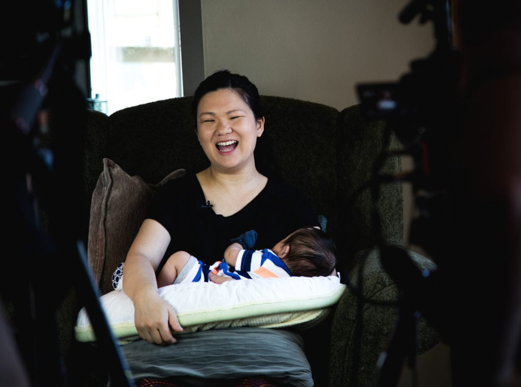 """Behind the scenes of filming the """"Baby Feeding Routine"""" on set at Fit2B Studio - fit2b.com - Upper Body Workout To Do While Feeding A Baby - fit2b.com - Babies spend about 11 hours per day eating from a bottle or breast. Join physical therapist, Gillian Sukachevin, and her 12-week old bub for a lovely stretching and exercise session you can do while feeding your infant"""