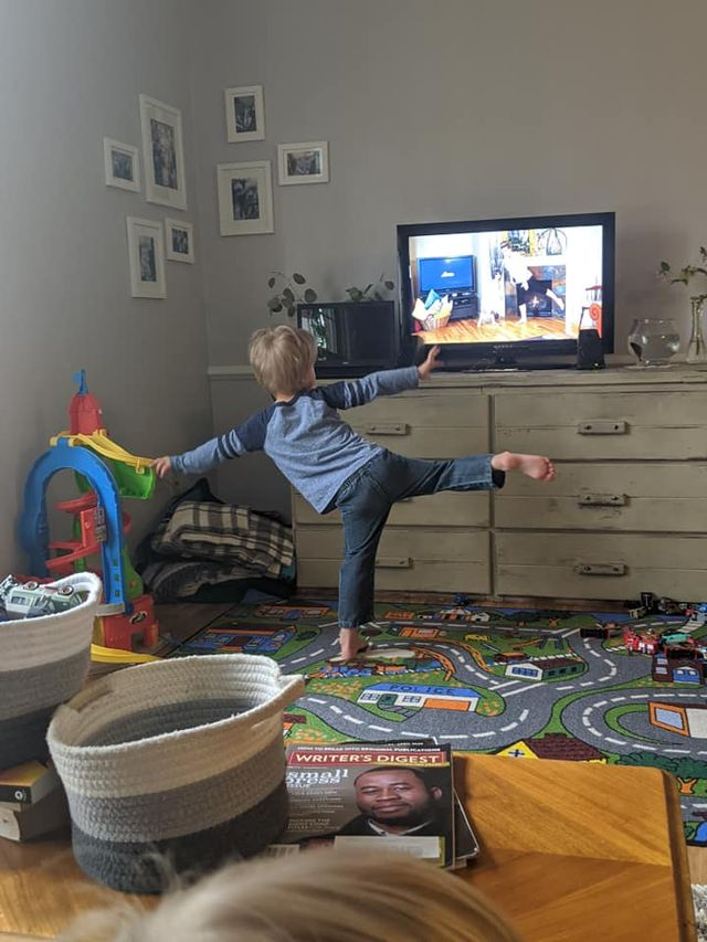 Little boy exercising at home with fit2b.com