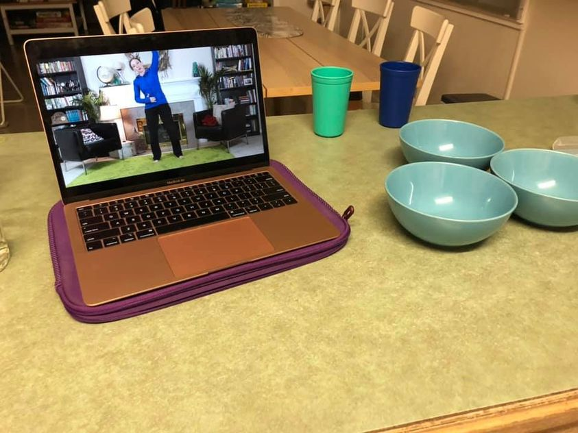 Fit2B on a laptop in a member's kitchen. Workout with us anywhere, anytime, on any device! -fit2b.com